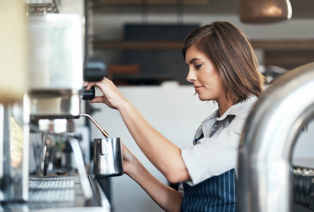 freshly brewed - barista making coffee stock photos and pictures