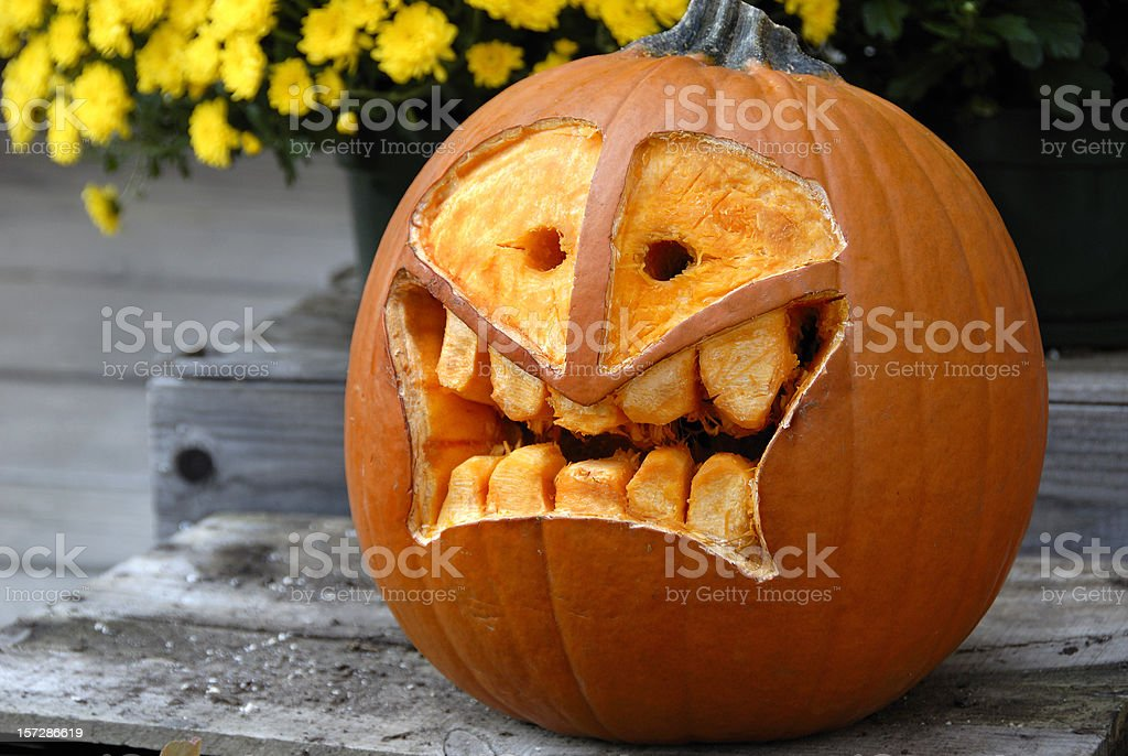 Freshly Carved Nontraditional Innovative Pumpkin Jack-o-lantern for Halloween stock photo