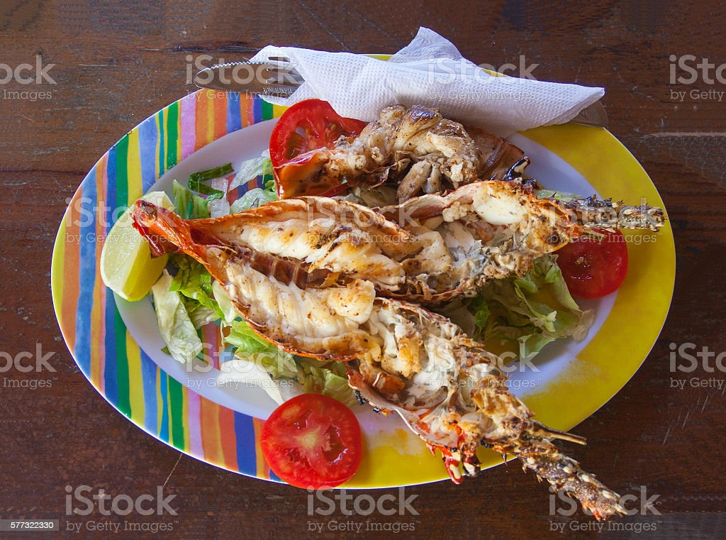freshly caught grilled lobster served in a colorful dish stock photo