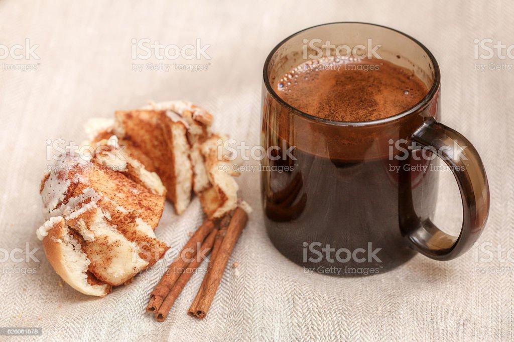 Freshly cinnabon French bun with cinnamon and coffee, selective focus stock photo