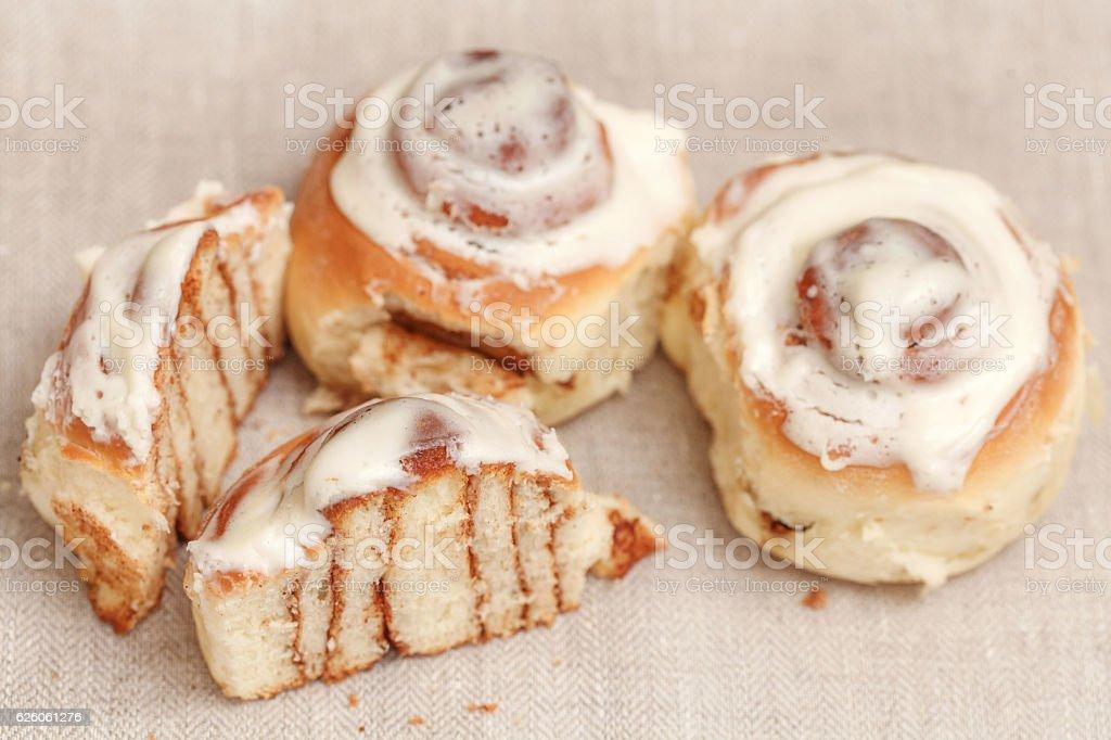 Freshly cinnabon French bun with cinnamon and cream, selective focus stock photo