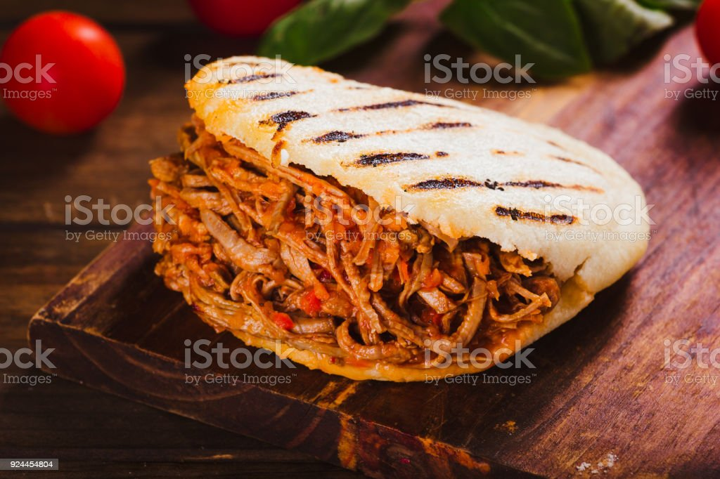 Freshly cooked Arepa with roasted meat stock photo
