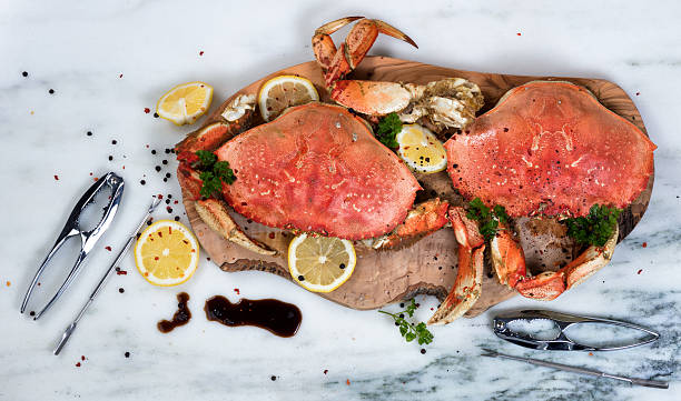 Freshly cooked crab with spices on wooden server stock photo