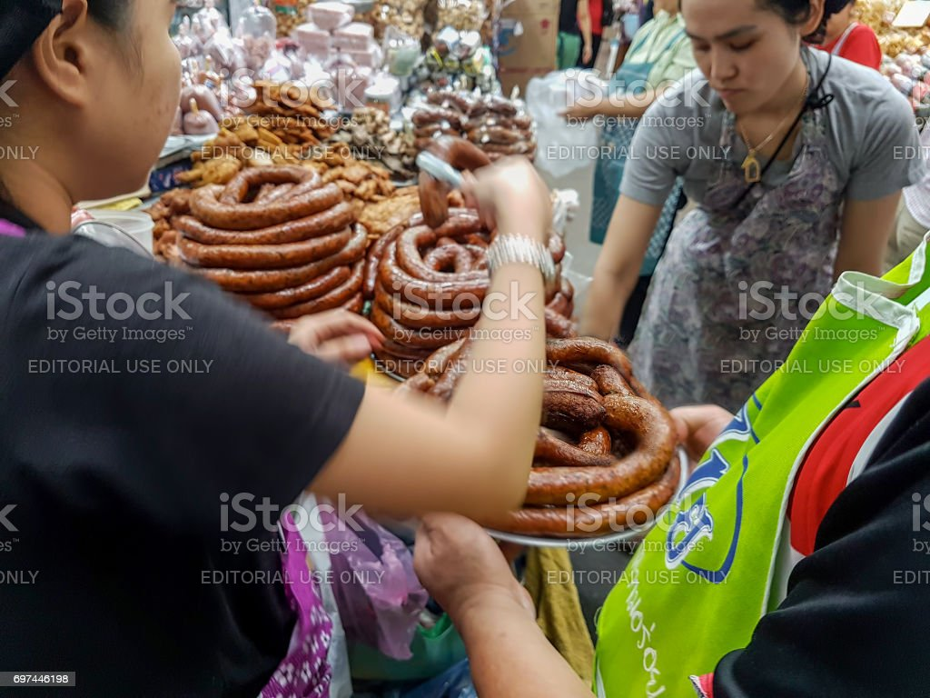 Freshly cooked Northern Thai sausage (Sai Or) for sale in Chiang Mai's old Worawot market. stock photo