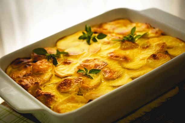 Freshly cooked Serbian moussaka meal in white casserole stock photo