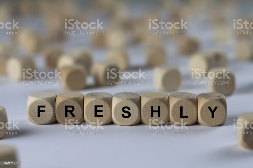 freshly - cube with letters, sign with wooden cubes stock photo