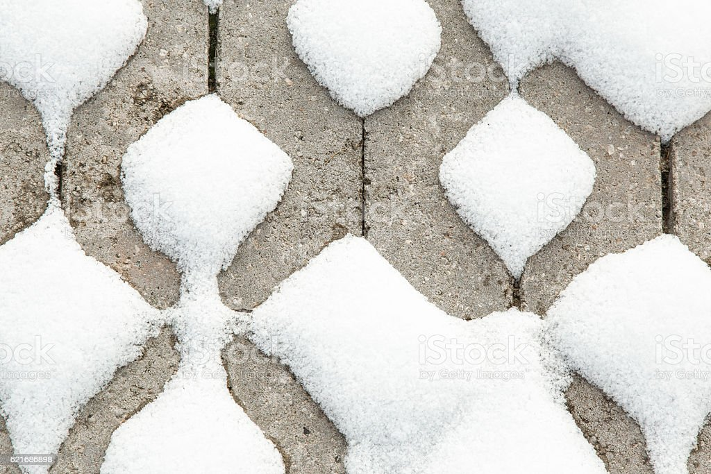 Freshly fallen snow on the pavement. Winter texture background. stock photo