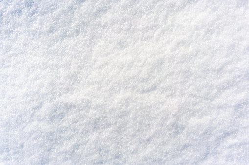 A close-up of a surface of freshly fallen December snow.