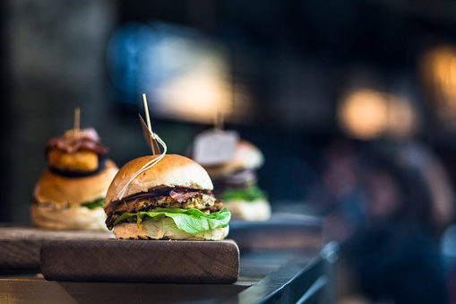 Freshly Flame Grilled Burgers At Food Market Stock Photo - Download Image Now