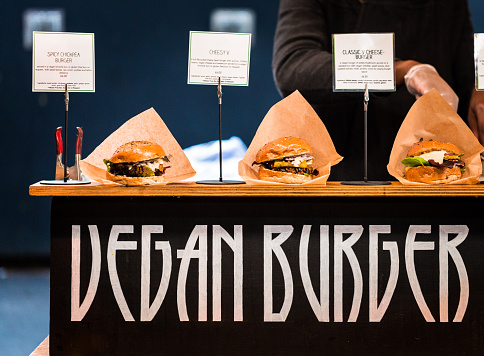 Freshly flame grilled Vegan burgers displayed in a row