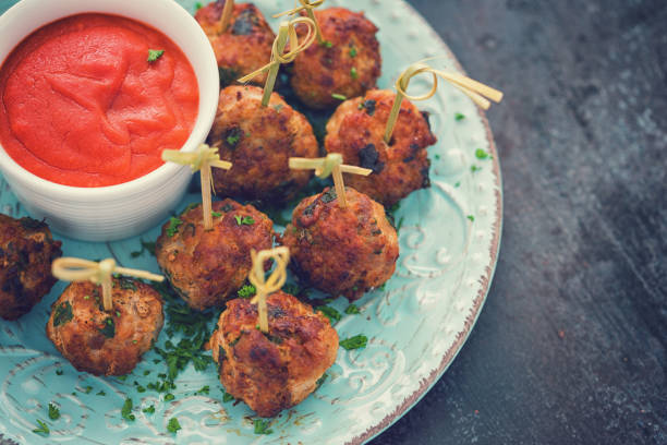 Freshly Fried Meatballs Freshly fried meatballs served with tomato sauce on the plate meatball stock pictures, royalty-free photos & images