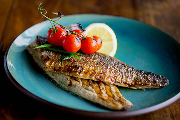 freshly grilled trout - trout foto e immagini stock
