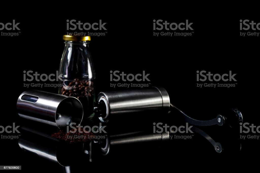 Freshly ground coffee beans with grinder. royalty-free stock photo