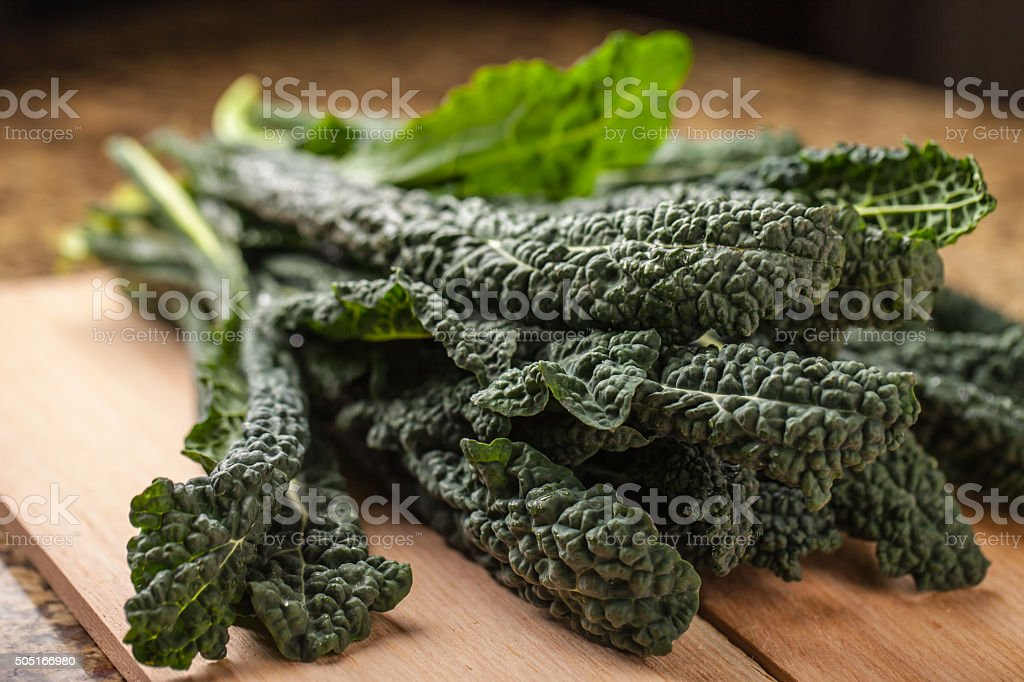 Freshly harvested lacinato kale on granite counter top stock photo