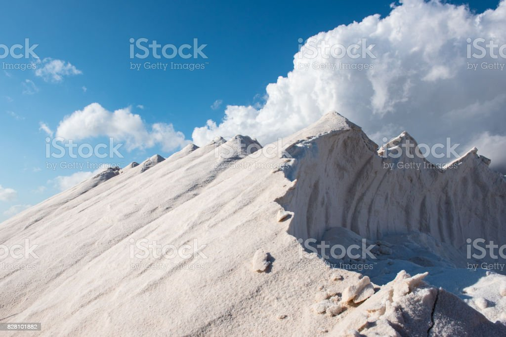 freshly harvested salt mountains before dramatic sky on Majorca stock photo