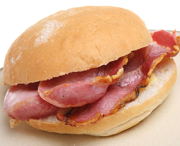 A freshly made bacon bap with cheese stock photo