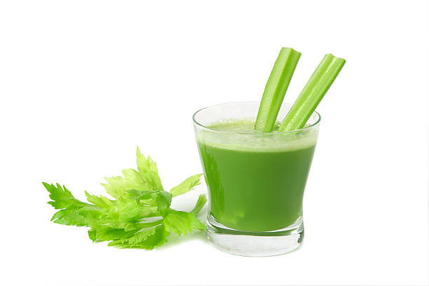 Freshly made bright green celery juice in a glass stock photo