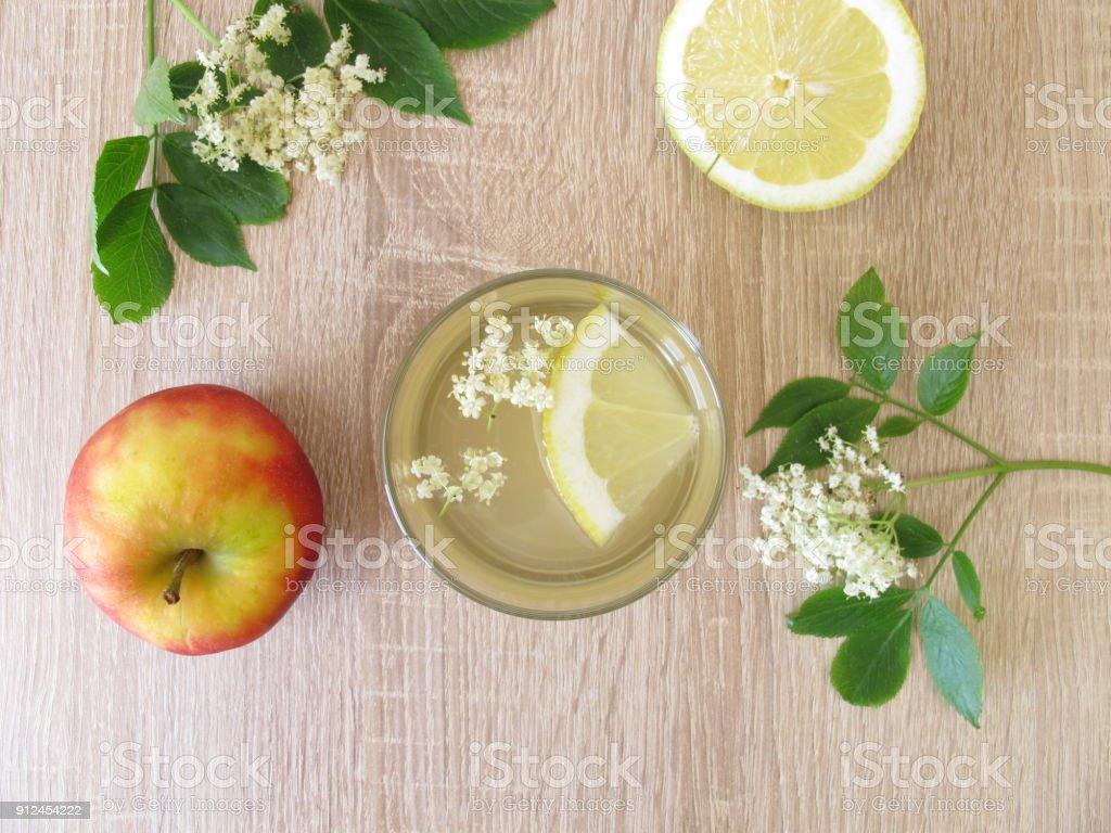 Freshly made lemonade with elderflowers, apple juice and lemon stock photo