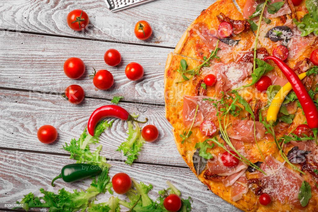 Freshly Made Prosciutto Pizza On A Rustic Table Background Whole Italian With Cherry Tomatoes
