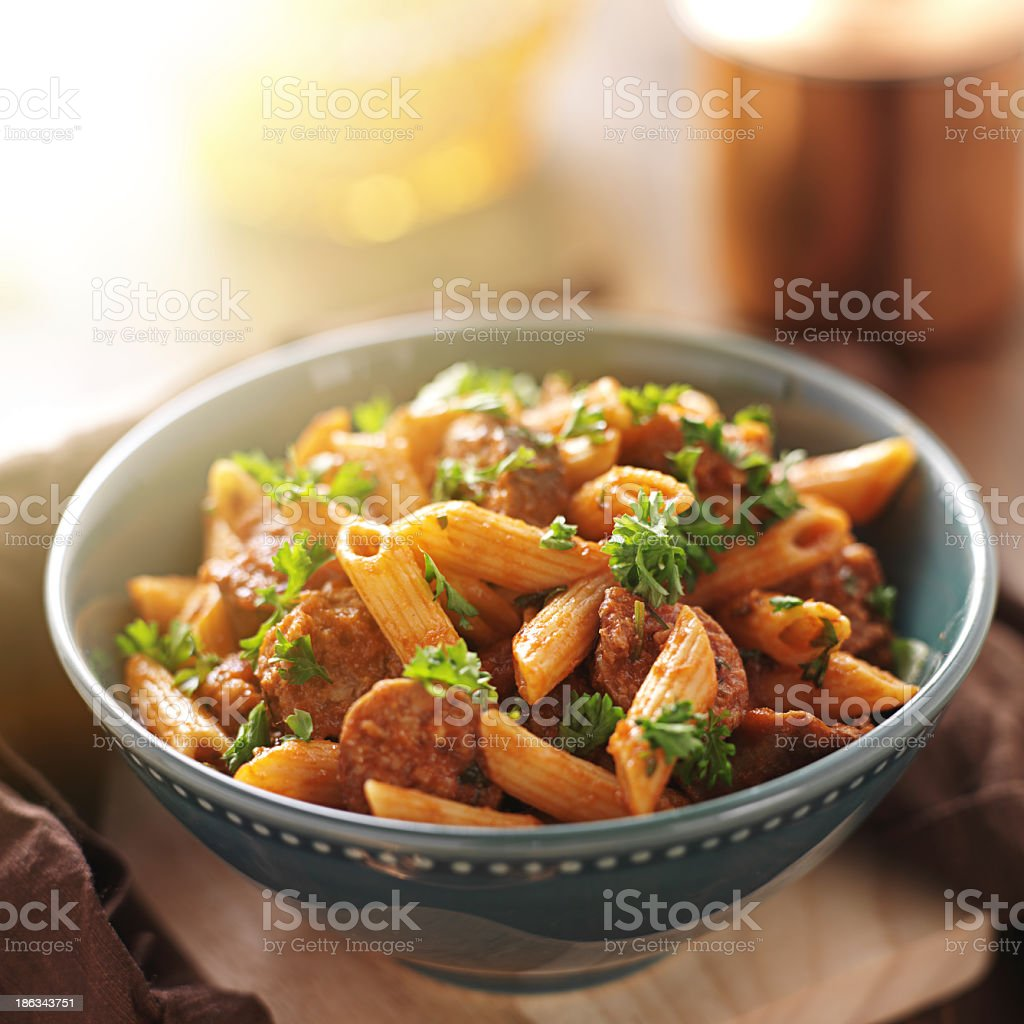 Freshly made rigatoni pasta with sausage and garnishing  stock photo