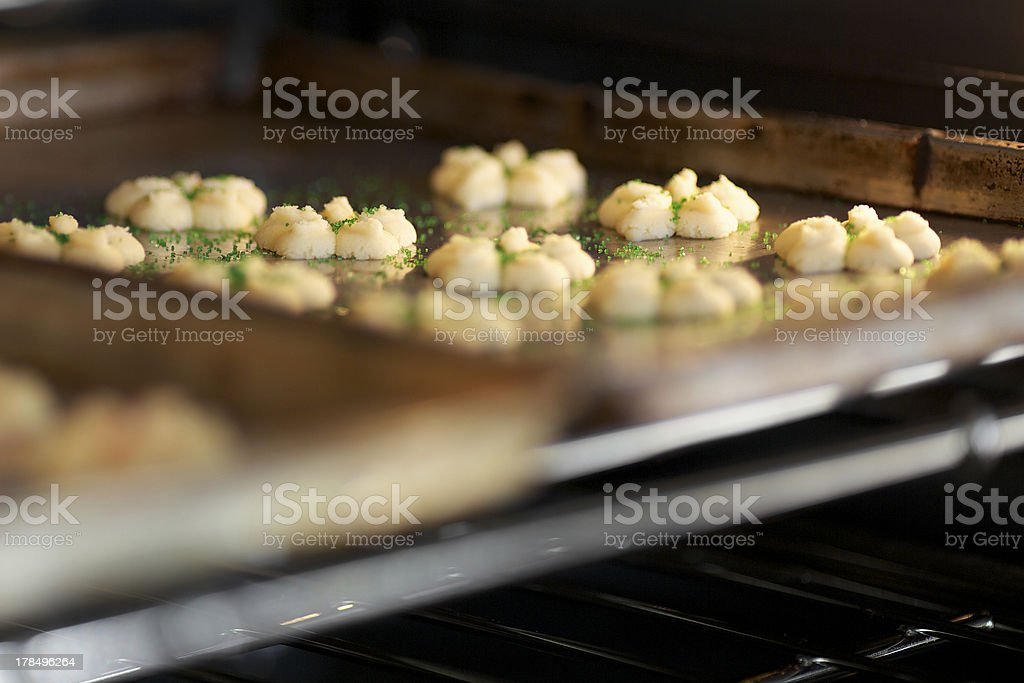 Freshly made sugar cookies in the oven for baking royalty-free stock photo