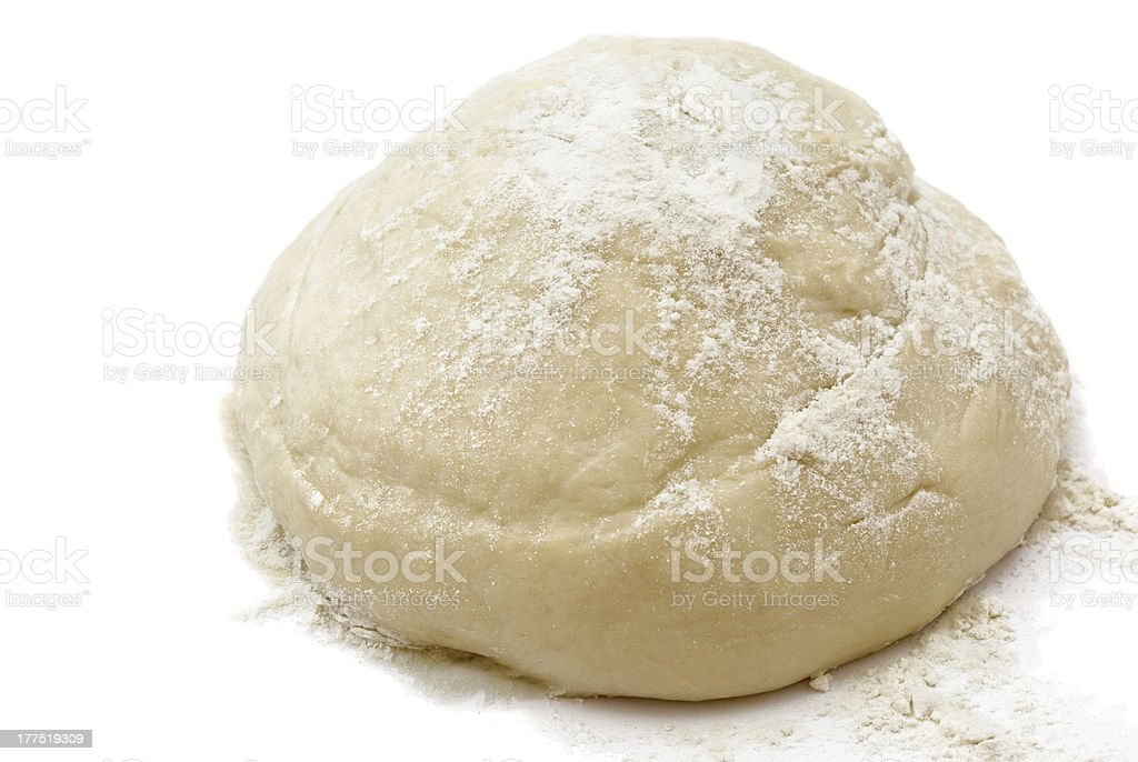 Freshly made white dough with flower on top isolated stock photo