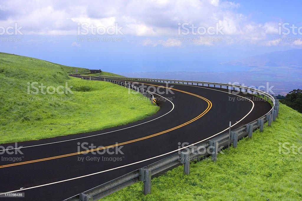 Freshly paved winding road stock photo