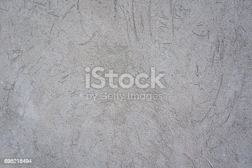 1138442636istockphoto freshly plastered with concrete wall 695218494