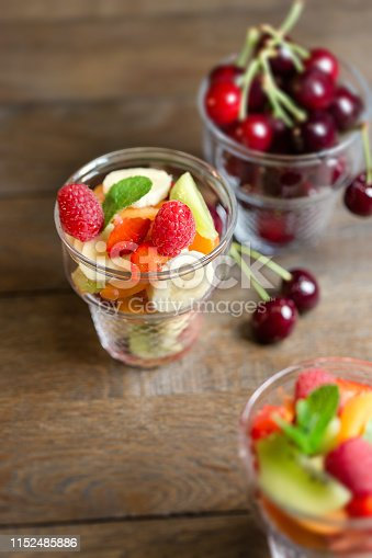 Freshly prepared fruit salad, a delicious meal in warm summer day