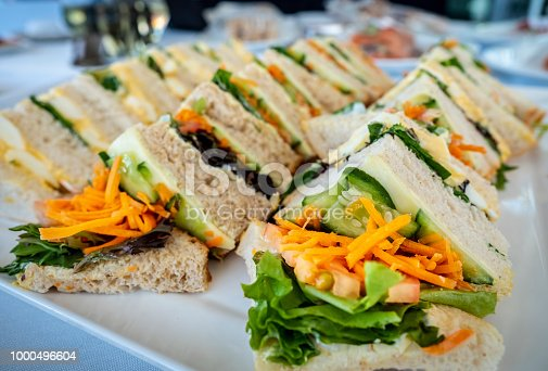 istock Freshly prepared sandwiches arranged on a large plate 1000496604