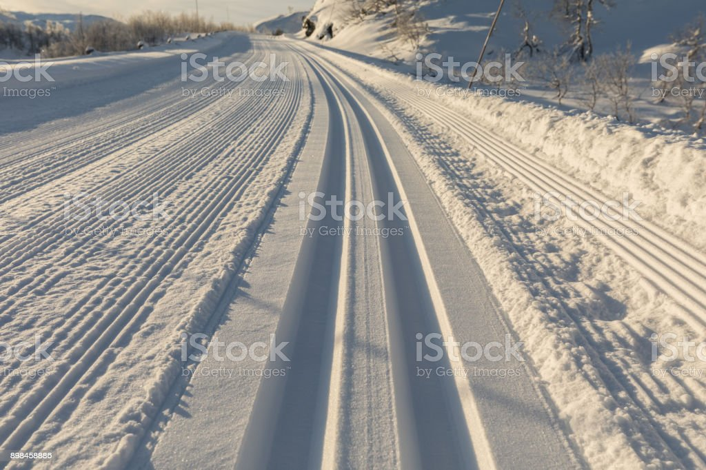 Freshly prepared ski tracks in the mountains in Setesdal, Norway. Close up stock photo
