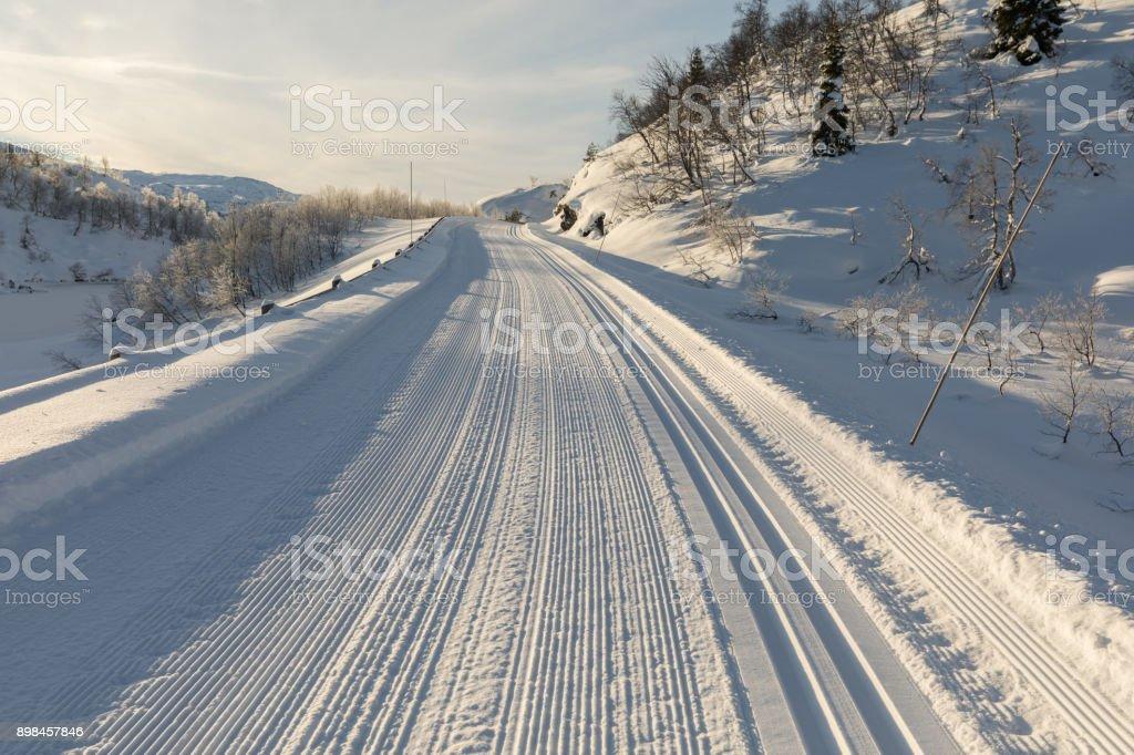 Freshly prepared ski tracks in the mountains in Setesdal, Norway stock photo