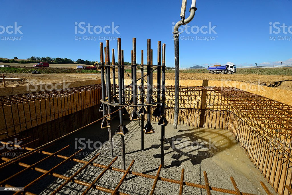 Freshly pumped concrete to cast bottom plate in contruction site stock photo