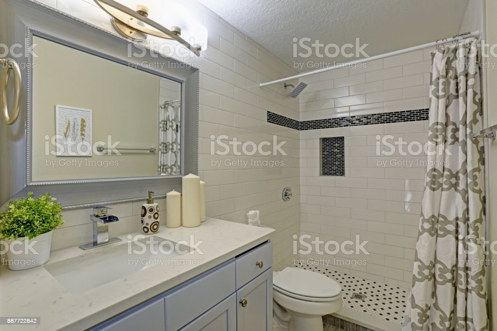 Freshly renovated bathroom with walk-in shower stock photo