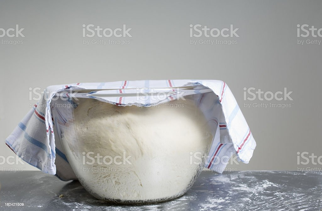 Freshly Risen Bread Dough In A Large Glass Bowl stock photo