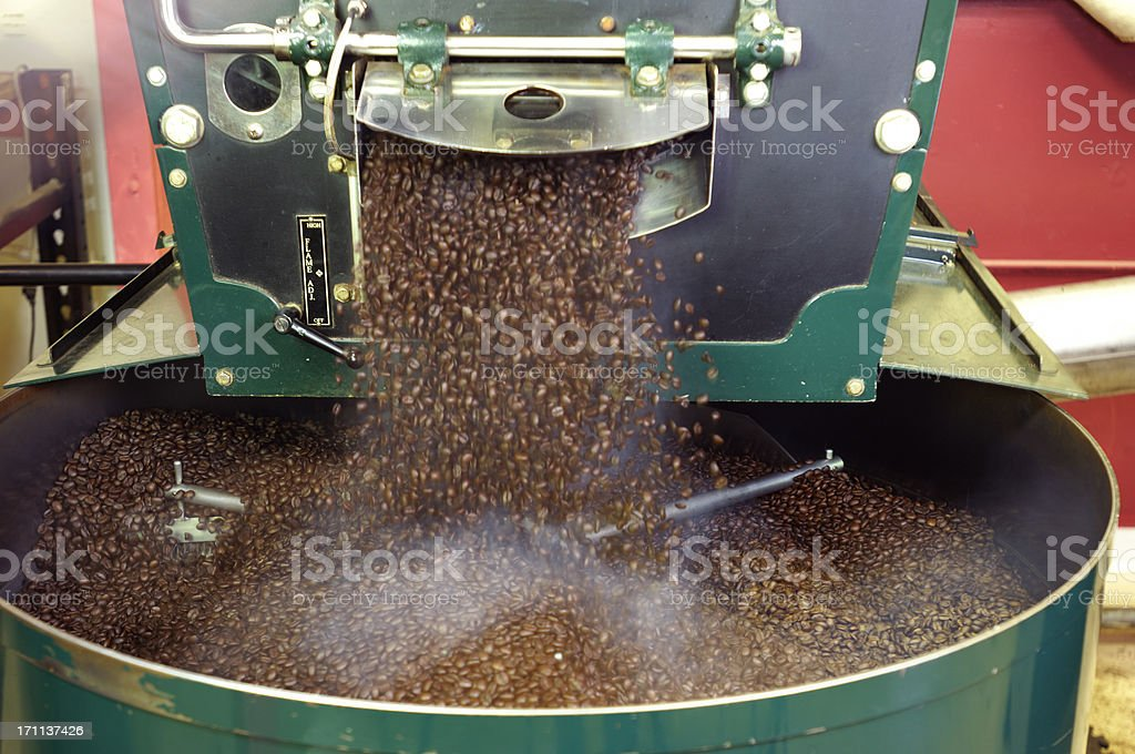 Freshly Roasted Coffee Beans Dropping from Hopper royalty-free stock photo