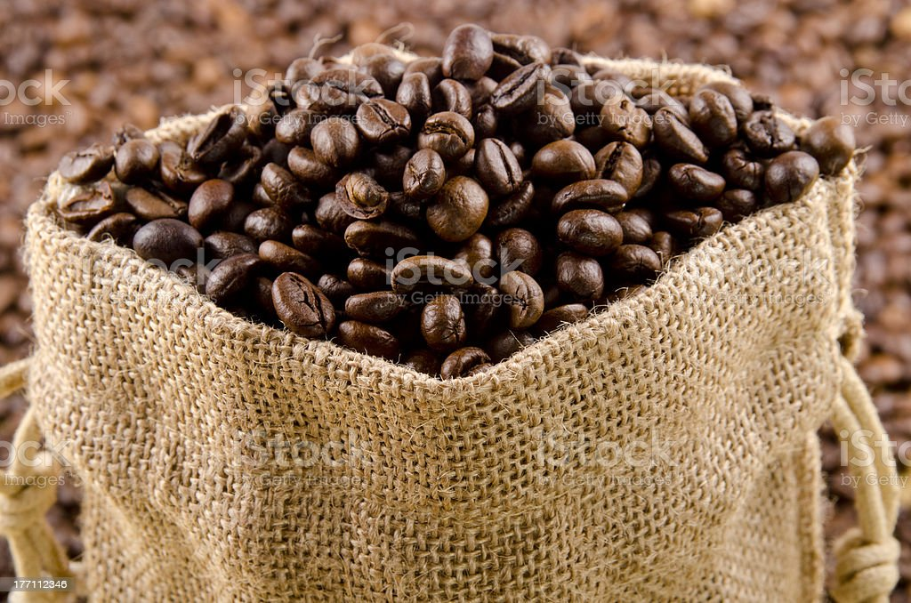 freshly roasted coffee beans in a jute bag royalty-free stock photo