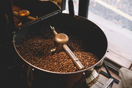 freshly roasted coffee beans n a coffee roaster