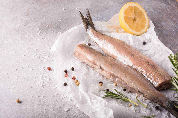freshly salted herring - herring stock photos and pictures