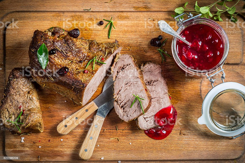 Freshly served venison with cranberries and rosemary stock photo