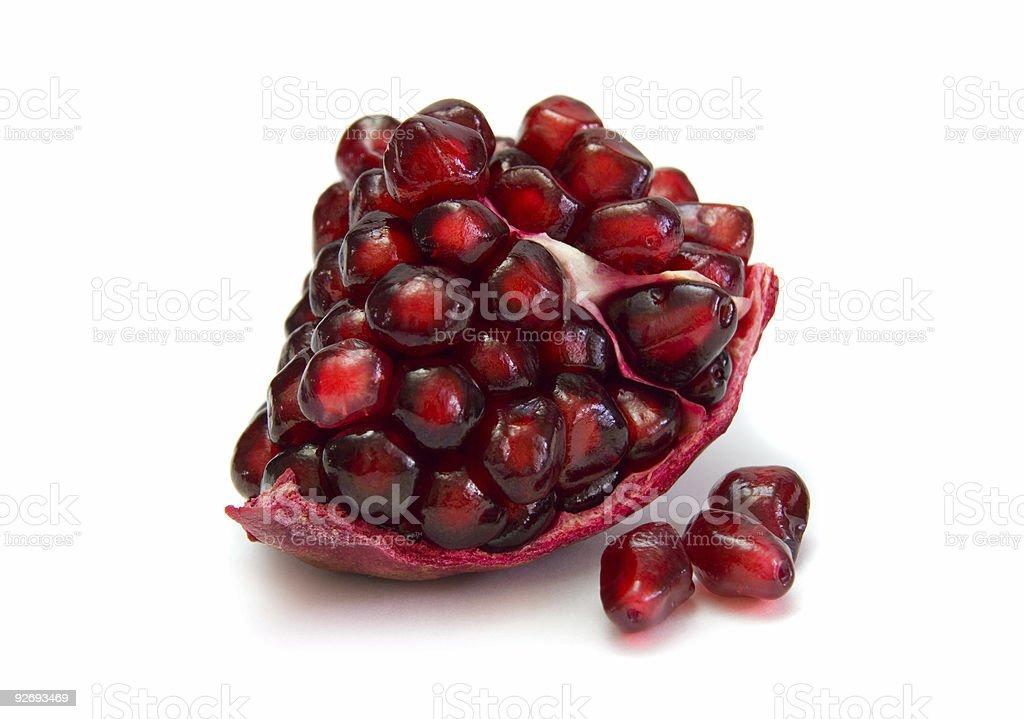 Freshly sliced pomegranate against neutral background royalty-free stock photo