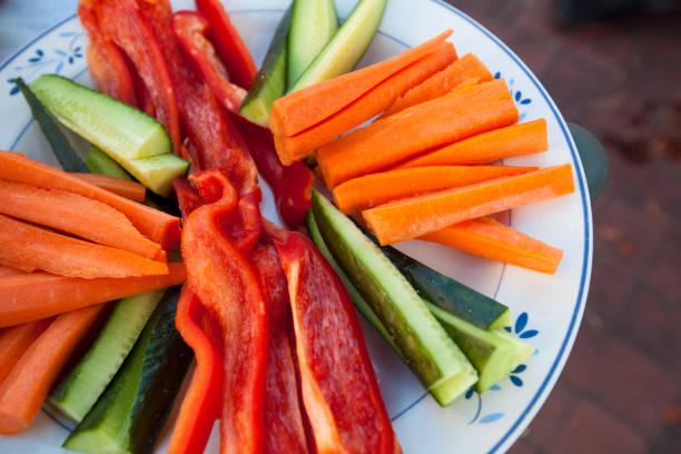 Freshly Sliced Vegetables on a Plate stock photo