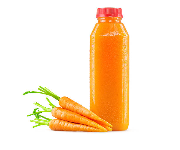 Freshly Squeezed Carrot Juice in Bottle on White Background A generic bottle of freshly squeezed raw carrot juice with a garnish of carrots on the side. Sitting on a 255 white background. The cold bottle of vegetable juice can accommodate any logo or brand name. vegetable juice stock pictures, royalty-free photos & images