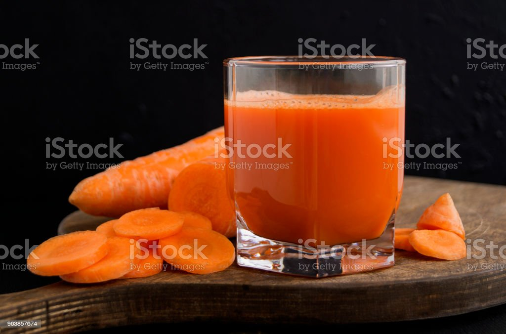 Freshly squeezed juice of carrots on black background - Royalty-free Breakfast Stock Photo