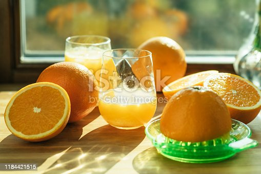 Oranges and two glasses with juice in the morning