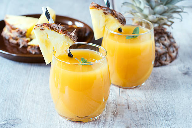 Freshly squeezed tropical fruit juice with pineapple  stock photo