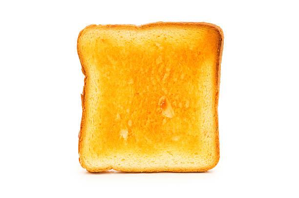 fresco pane tostato isolato su sfondo bianco - fette biscottate foto e immagini stock