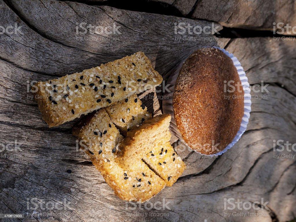 Freshly toasted salt and sesame bread ,banana cupcake on wood royalty-free stock photo
