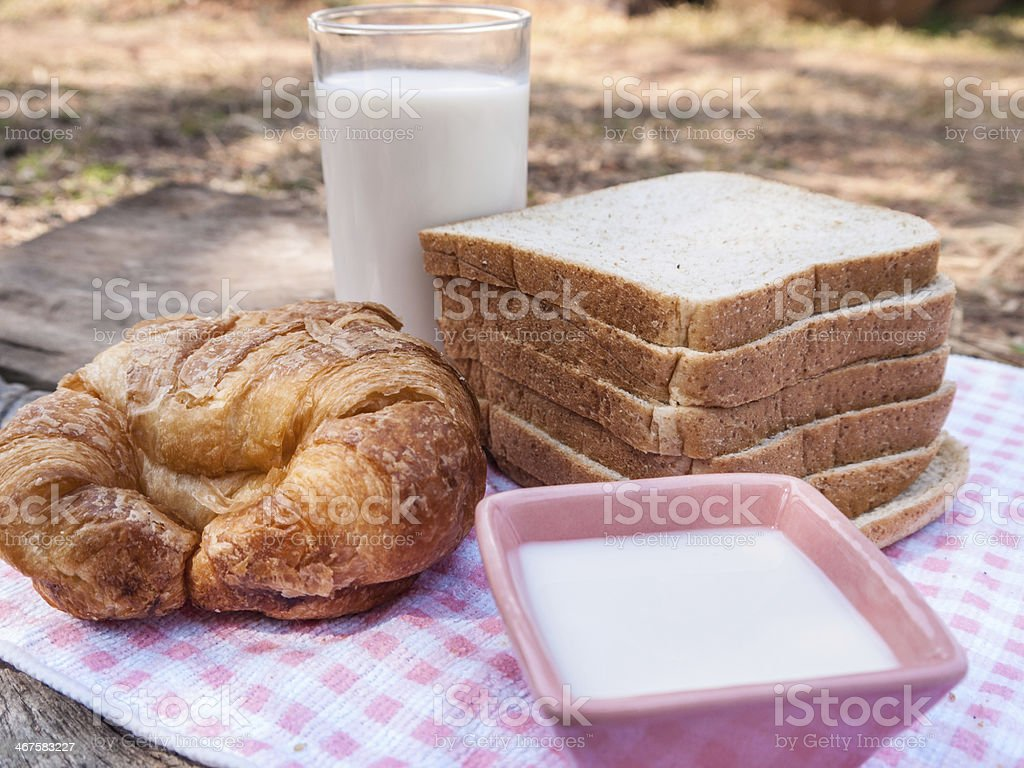 Freshly toasted salt and sesame bread, croissant,milk royalty-free stock photo