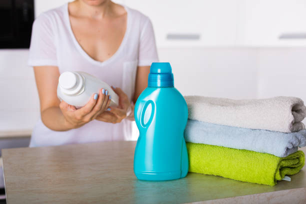Freshly washed laundry Freshly washed laundry with detergent and fabric softener laundry detergent stock pictures, royalty-free photos & images